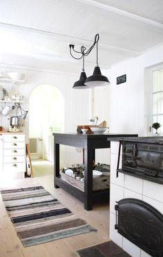 white / kitchen / wood / floor / black / hang / lamps