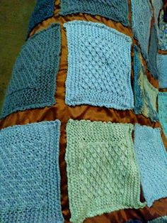 My lastest Creation Chronicle involves an unconventional mixed media quilt consisting of woolly knitted squares on a satin base. Quilt Binding, Quilt Sizes, Rust Color, Satin Fabric, Shades Of Blue, Knitted Fabric, Mixed Media, Quilts, Studio