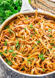 One Pot Fettuccine with Beef Ragu - nothing says comfort food like a big bowl of meaty and delicious pasta. This fettuccine is cooked in a hearty beef sauce making for a quick and easy dinner.