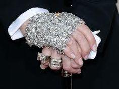 Madonna styled big initials on her glove-free hand. #Grammys2014