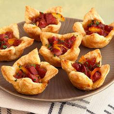 These bite-sized appetizers feature spicy kielbasa flavored with Dijon-style mustard and marmalade atop flaky puff pastry cups. Mini Muffin Pan, Muffin Tins, Bite Size Appetizers, Kielbasa, Mini Muffins, Marmalade, Baking Pans, Sausage, Spicy