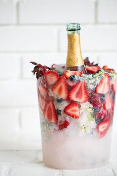 Keeping Champagne and wine chilled has never look better with these charming DIY floral ice buckets! They're colorful, festive and can be fully customized. Imagine kiwis, apples and flowers! They look beautiful sitting on a table and are perfect for summer entertaining. We love how they came out! See the how-to below. Cheers to DIY ice buckets!!...read more