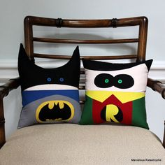 These 10 inch by 10 inch pillows are the perfect size for snuggling or for decorating a superhero themed room.    They are made from cotton fabric, with polyfill stuffing, and small buttons for eyes.    Batman is wearing his traditional gray suit with the black Bat symbol. He has a bright blue cape, a black mask, and bright blue eyes.    Robin is wearing a red and green suit with a yellow collar and R on the front. He has green eyes and a black mask to hide his identity, and his hair is…