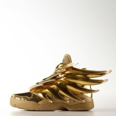 Wings 3 Gold Shoes Fashion visionary Jeremy Scott's latest iteration of his beloved winged shoes, these Wings 3 sneakers feature a lustrous gold metallic upper and futuristic spiky wings that sweep energetically across the upper. They're finished with Jeremy Scott's signature on the heel.