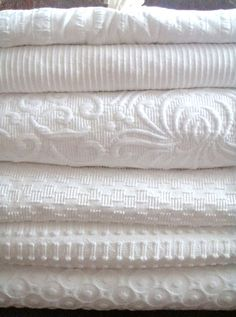 White coverlets: I& love to add these to my linen closet. I& a fanatic for using only cotton on the bed (there& nothing more comfortable for sleeping) AND for adding that one textured piece to give the bed that luxurious feel. White Coverlet, White Bedding, White Bedspreads, Cream Bedding, Coverlet Bedding, Chenille Bedspread, White Bedroom, Bedding Sets, Comforters