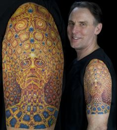 WOW! Kudos to the tattoo artist for this! And to this guy for getting Alex Grey…