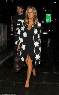 Dazzling: Caroline Flack leaves the X Factor wrap party at One Marylebone, London, in a low cut black dress and cloud-print coat