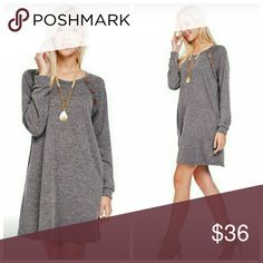 Long Sleeve Sweater Dress 82% Polyester 15% Rayon 3% Spandex   Buttons are on both sides of the dress. Her arm is covering the buttons.   Made in USA Dresses Long Sleeve