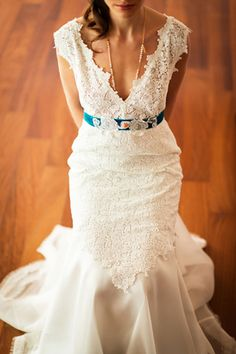 A romantic wedding dress by designer Katia Delatola.Made with exquisite cotton lace from Switzwerland and silk organtza. A detail that I completely adore: the dark turquoise velvet belt! A detail that will surely make this romantic wedding dress at the top of your list! http://www.love4weddings.gr/romantic-wedding-dress-katia-delatola/ #weddingdressbelt #romanticweddingdress #katiadelatola