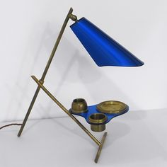 Desk lamp- Italy 1950s.  Plexi-Glass shade and shelf with brass compartments and fittings.