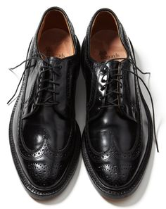 "Allen Edmonds ""MacNeil"" Oxford     When we talk about wingtips at GQ, we talk about them with a lot of passion and gravitas. A black wingtip is one of the most worthwhile and elegant shoes a man can have in his wardrobe. It stands up to dressier fall flannels, but looks just as appropriate with a pair of khakis or corduroy jeans. This pair walks the line perfectly between being too chunky and too refined: The proportions are just right."