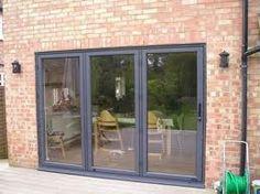 bifold doors - 3 big ones Grey Window Frames, Grey Windows, Windows And Doors, Bungalow Extensions, House Extensions, Portal, Aluminium French Doors, Concertina Doors, Grey Doors