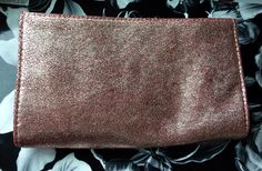 Bare Escentuals magnetic top clutch. New. $8