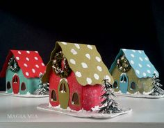 Original Magia Mia Putz house design for Christmas.  Inspired by the old, humble Putz houses with spotted roofs to represent snow, I created this sweet little storybook house. I added more whimsy by cutting the roof with curvy edges. This listing is for Red & Moss green house. Other houses sold Separately.  A plastic tree and handcrafted mini sisal wreath are coated with red & crisp moss green German glass glitter, and snow paint.  Handmade tinted windows using transparency film. A hole is…
