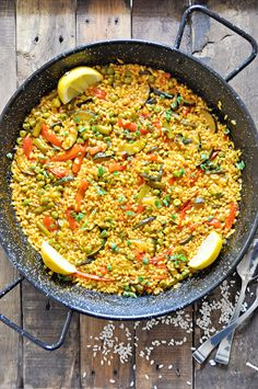This recipe for Spanish Vegetable Paella is a delicious alternative the the original Paella Valenciana can be enjoyed by vegetarians and vegans alike! Spanish Vegetables, Whole Food Recipes, Snack Recipes, Cheap Meals, Cheap Recipes, Spanish Food, Lunches And Dinners, Paella, Tapas