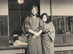 John & Yoko standing in front of japanese   traditional house