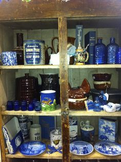 McAffee Mercantile in Treasures Antique Mall Blue white vintage brown drip old bottles books lard tins LDS