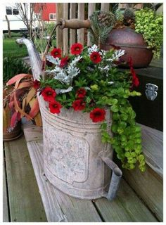 Old watering can, red petunias, creeping jenny to trail over, and silvery dusty miller...oh ya, baby...BAM