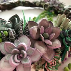 Close up of Licia Politis's quilled succulent wreath. She shares how she made it at the link. #quilling #quilledsucculents #paperplants