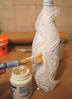 How To Decoupage On Glass Bottle With Pizzi Goffre Technique. Step Sticking the lace on object bottle crafts How To Decoupage On Glass Bottle With Pizzi Goffre Technique - The Fairy Pin Glass Bottle Crafts, Wine Bottle Art, Diy Bottle, Vodka Bottle, Painted Glass Bottles, Decorated Bottles, Bottle Vase, Glass Jars, Decoupage Glass