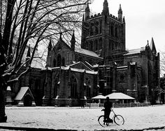 Hereford Cathedral in the Snow #monochrome #Elgar # Dailyshoot #leshaines We are all taking snow photos at the moment and I always go back to my favourite location the ancient cathedral in Hereford. Converted to mono to show the contrast, and focused more on getting the composition right. Cant quite seem to get Elgar leaning on his bike in the right place! Like the shot though and no doubt Ill go back over and over again! Image slightly cropped.