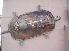 """""""wall turtle"""" found, forged, and fabricated steel and poured bronze. shell is from a wheelbarrow.2010 by steven brock. (sold)"""
