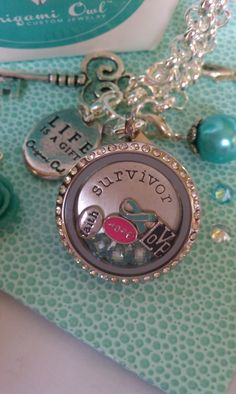Ovarian Cancer Survivor - Origami Owl Living Lockets.  Contact me about raising money for your special cause.   www.kimberlym.origamiowl.com