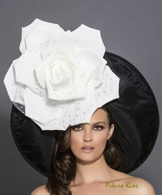 Gorgeous new Derby hat from my new 2016 Collection.  Rolled up hat made of Black taffeta, adorned with a big foam rose with polka dot tulle petals. One size fits most. All my hats are hand made to order please allow -1-2 weeks while we make and ship it. If this is a rush order, please contact me first to make sure we can make it on time. All sales are final, please feel free to contact me for any questions.  Thank so much :) Arturo.
