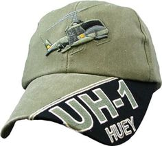 UH-1 Huey Helicopter Embroidered Baseball Cap Features: - Embroidered lettering and badge - OD Green - 100% cotton - Adjustable
