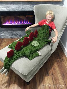 This is a PDF crochet pattern for a Bulky Stegosaurus (Dinosaur) Blanket! This…
