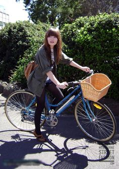 Emily Browning = fashion while riding a bike! Tights and parka