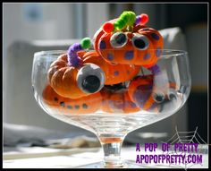 Adorable no-carve mini pumpkin monsters (Super-easy Halloween kids' activity) ~All you need is: •a bag of mini-pumpkins or gourds •googly eyes •paint •pipe cleaners •mini pom poms.  ~Wrap each of the stems in a chenille pipe cleaner. and help glue on googly eyes with a glue gun (way to hot for little fingers)
