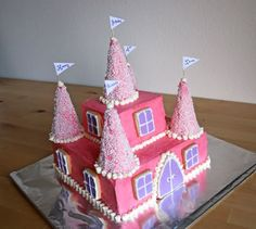 Half the Sugar Bowl: A Very Pink Princess-Castle Cake - the nite before and we found Emmy's cake.  :)  Maybe not exactly like this, but close. . .