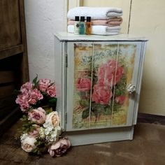 Such a pretty little cupboard.  Painted with Annie Sloan Old White, Chateau Grey & Olive Chalk Paint. Rose grower advert image transfer and stencilled shelf. Lightly distressed, clear and dark waxed. #misselaineous #anniesloan #chalkpaint #morethanpaint #reloved #oldwhite #chateaugrey #olive #cupboard #imagetransfer #rose #roses #floral #pretty #countrystyle #cottagegarden #floribunda #vintage #shabbychic