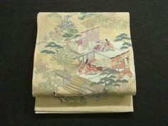 This is an elegant Fukuro obi with a design of Ise story, which is woven with juko-ori technique.   It has a design of seasonal flowers and tale of Heian era vibrantly.
