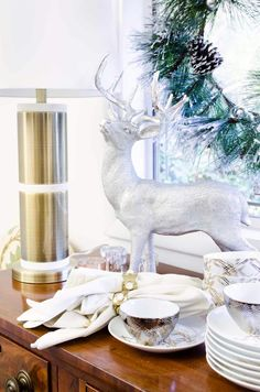 Silver reindeer figurine, brass and marble lamp, and entertaining essentials from @TargetStyle