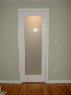 Bathroom Doors pocket door with glass, would love to switch out the bathroom door