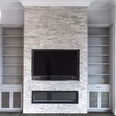 Just Installed. A room completely transformed with an inviting feature wall, beautiful material selection, custom cabinetry and a sleek linear fireplace. - centre - Book Your Complimentary In-Home Design Consultation organizedinteriors. Fireplace Feature Wall, Tv Feature Wall, Feature Wall Living Room, Fireplace Tv Wall, Linear Fireplace, Basement Fireplace, Family Room Fireplace, Fireplace Remodel, Modern Fireplace