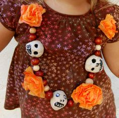Day of the Dead necklace--growing up in AZ and living in NM, Dia De Los Muertos (Day of the Dead) is a holiday that we were always around, as well. Since my toddler is obsessed with anything bones, this necklace gearing up for Nov. 1 was a huge hit! (We made extra salt dough skulls to use as counting/sorting tokens, too)
