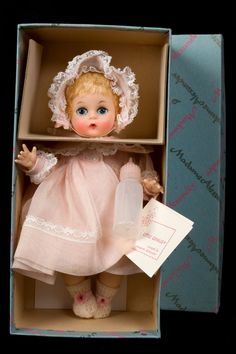 Madame Alexander Little Genius , I had one of these back in the 50s, I had clothes and the wooden furniture too.