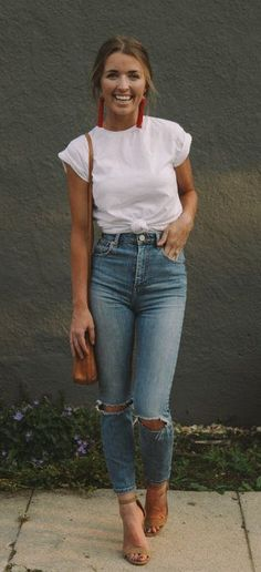 #fall #outfits women's white crew-neck t-shirt and distressed blue jeasn