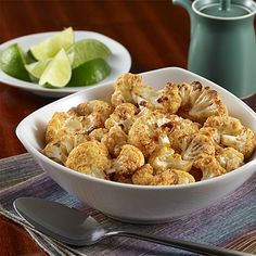 **Substitute Brussel Sprouts Spicy Roasted Sriracha Cauliflower: A spicy side dish recipe of roasted fresh cauliflower flavored with Sriracha sauce, soy sauce, rice vinegar and garlic Easy Vegetable Recipes, Vegetarian Recipes Easy, Healthy Eating Recipes, Vegetable Side Dishes, Spicy Recipes, Cooking Recipes, Haitian Recipes, Healthy Side Dishes, Side Dish Recipes