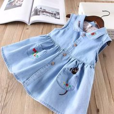 Buy Hurave New baby girls clothes Turn-down collar denim sleeveless button Kids Clothes cartoon embroidery causal pocket dresses Frocks For Girls, Kids Frocks, Little Girl Dresses, Girls Dresses, Kids Dress Wear, Baby Dress Design, Baby Frocks Designs, Baby Girl Dress Patterns, Cute Dresses