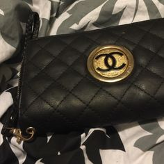 A Black wallet I think is a Chanel knockoff! A black pretty wallet! Honestly I don't remember what brand of a wallet it is but it is a beautiful wallet I think someone will like! I wore this wallet for a while so it has plenty of wear but still in good condition CHANEL Bags Wallets