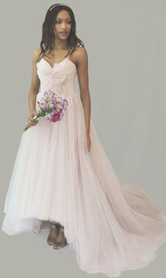 Blush by Hayley Paige, style 1258 in a size 12. RRP: £1550, Now £800 - Layered blush and violet tulle ball gown. Available to try on at Betty Gets Hitched.