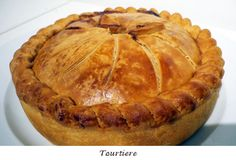 Tourtiere filled with minced pork or veal or beef...I love anything that comes in a pastry as golden as this!