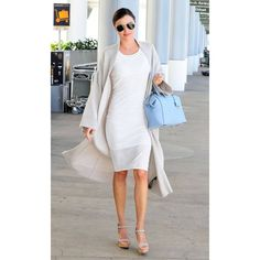 Miranda Kerr Celeb Airport Style From the Messy to the Dressy ❤ liked on Polyvore featuring backgrounds and people