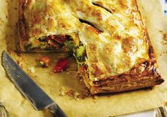 Crispy puff pastry encases roast vegetables and houmous in this easy-to-make pie that costs less than £5 to make.