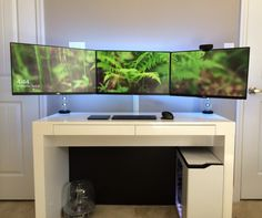 Simple Minimalist White Gaming Computer Desk setup with Large Triple Monitors and White NZXT H440 PC Case