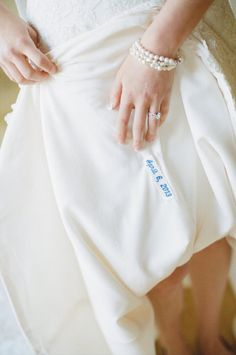 something blue. your wedding date stitched onto a tag in your wedding dress
